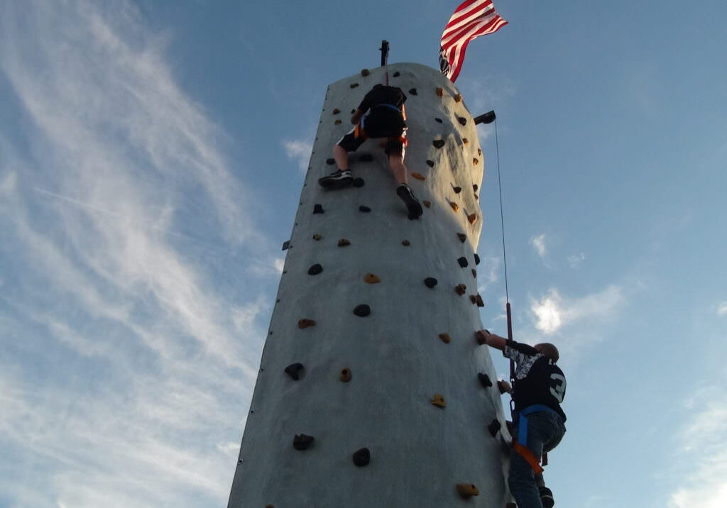 2 kids climbing rock wall
