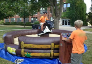 Man riding mechanical bull